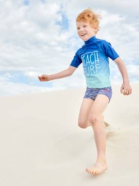 Click to view product details and reviews for Uv Protection Swim T Shirt Surf Motif For Boys Blue Medium Solid With Design.